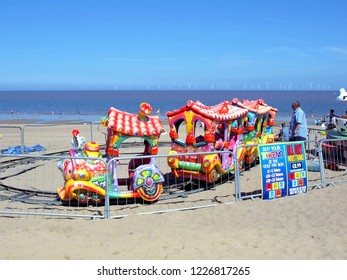 Ingoldmells, Lincolnshire, UK. July 17, 2014. Holidaymakers enjoying  a children's train ride on the beach at Ingoldmells near Skegness in Lincolnshire, UK.