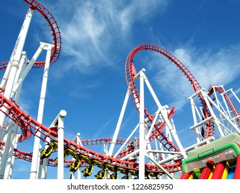 Ingoldmells, Lincolnshire, UK. July 17, 2014.  Roller Coaster loops against a Summer with sky with riders at Fantasy Island, Ingoldmells, Skegness, Lincolnshire, England, UK.
