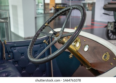 Ingolstadt, Germany - April 9, 2019: Audi 22/55 TYP E Phaeton 1913 old classic retro vintage 1910s car steering wheel and dashboard. Audi museum mobile.