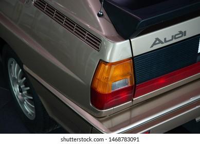 Ingolstadt, Germany - April 9, 2019: Audi Quattro (Ur-Quattro) classic German 1980s sport expensive famous car in the Audi Museum Mobile. Taillight, classic shape and Audi emblem badge.
