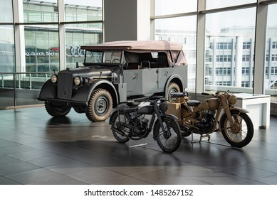 Ingolstadt, Germany - April 9, 2019: Horch 901 Typ 40 Kfz 15 1941 German army World War II 1940s military vehicle car and DKW war time motorcycles
