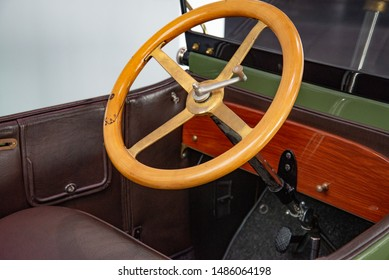 Ingolstadt, Germany - April 9, 2019: 1914 Wanderer 5/15 PS Typ W3 'Puppchen' classic German compact 1910s retro old ancient green car steering wheel