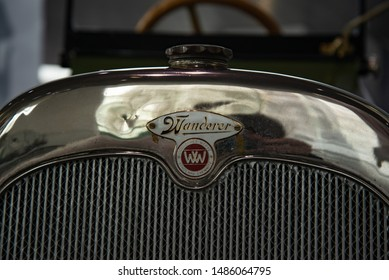 Ingolstadt, Germany - April 9, 2019: 1914 Wanderer 5/15 PS Typ W3 'Puppchen' classic German compact 1910s retro old ancient green car radiator grill emblem badge