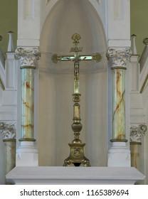 INGONISH BEACH, NOVA SCOTIA/CANADA - JULY 21, 2018: Brass cross between two pillars inside the St. Peter's Roman Catholic Church at 37384 Cabot Trail in Ingonish Beach