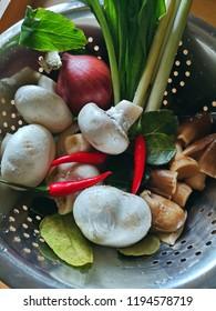 ingredient for cook tomyum are mushroom,shallot ,lemon grass, chilli, culantro and lemon leaf or kaffir lime leaf in a basket