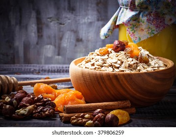 Ingredient for granola: oatmeal, dried fruits, nuts. Selective focus, toned