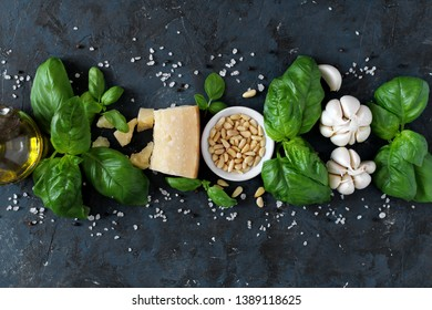 Ingredient for making traditional Italian sauce pesto: basil leaves, parmesan cheese, olive oil, pine nuts, garlic and sea salt. Top view with copy space.