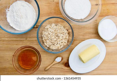 Ingredients for Anzac biscuits a traditional Australian cookie made for Anzac Day They are made with flour, rolled oats, butter, golden syrup, desiccated coconut, sugar, baking soda & water, flat lay
