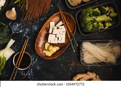 Ingredients for asian ramen soup. Noodles, spring onion, tofu cheese, mushrooms, chicken breast , bok choy cabbage green leafy  flat lay