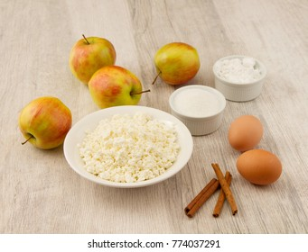 Ingredients for Baked apples with the curd filling and cold ice cream on wooden background