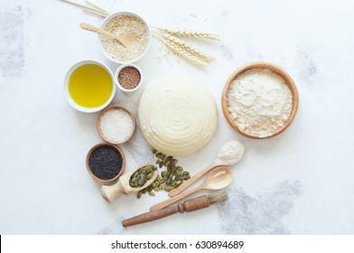 Ingredients for baking bread. Preparation of the bread before baking. White background. Space for inscriptions.