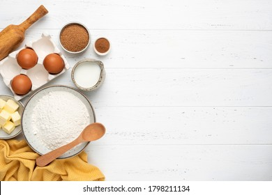 Ingredients for baking a cake cookies or sweet pastry on white wooden table background