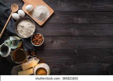 Ingredients for baking on a wooden background top view
