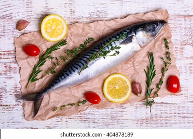 ingredients for baking scomber fillets, include raw mackerel, lemon, garlic, rosemary