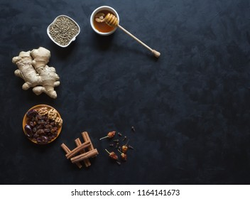 Ingredients for baking using ginger, cinnamon, cloves, dried fruit and hemp seeds.