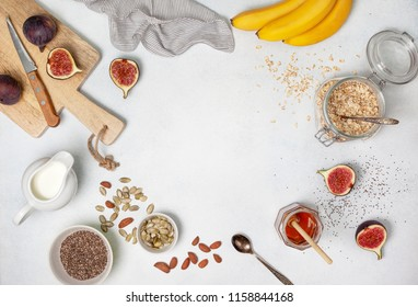 Ingredients for breakfast: oatmeal, milk, figs, bananas, pumpkin seeds. view from above