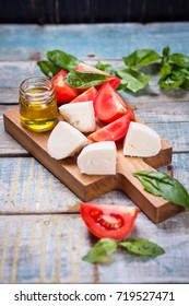 ingredients for caprese salad-fresh tomatoes and mozzarella