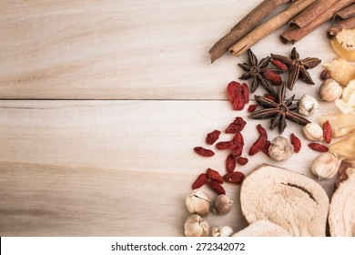 Ingredients for Chinese herbal soup on wooden background.
