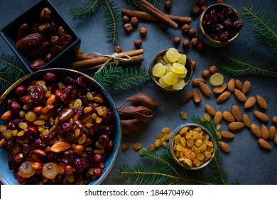 Ingredients for Christmas fruit cake  (nuts and dried fruits). Ceramic bowl with nuts and soft fruit soaked in brandy. Top view.