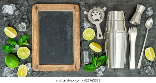 Ingredients for cocktail drink. Lime and mint leaves. Chalkboard for Your recipe text
