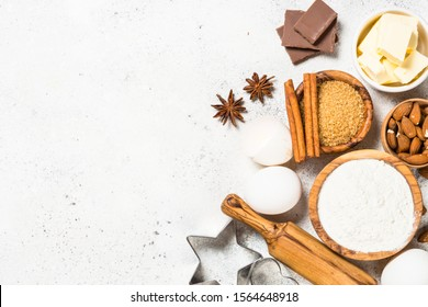 Ingredients for cooking baking. Flour, sugar, eggs, spices and utensil on white background top view.