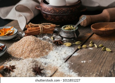 Ingredients for cooking bread or cookies: oat bran, flour, different spices on rustic wooden background. Healthy food concept. Food background.