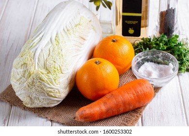 Ingredients for cooking cabbage salad with oranges and carrots. Healthy eating