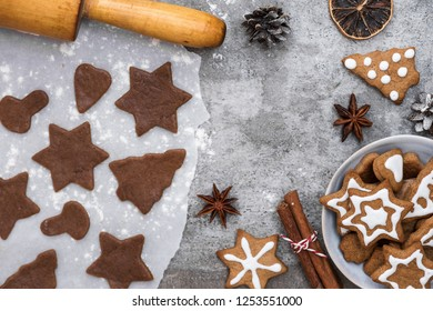 Ingredients for cooking Christmas gingerbread cookies with decorations on stone background, top view with copy space. flat lay