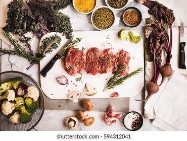 Ingredients for cooking. fresh vegetables and pork steaks. Top view. Healthy and dieting cooking ingredients.