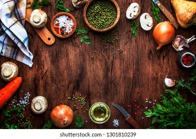 Ingredients for cooking green lentils with mushrooms and vegetables, spices and herbs, vintage wooden kitchen table background, place for text. Vegan or vegetarian food, clean food concept.  - Shutterstock ID 1301810239