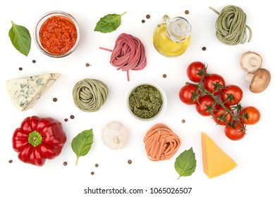 Ingredients for cooking pasta: cheese, tomatoes, olive oil, sauce. Top view.