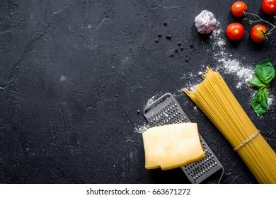 ingredients for cooking paste dark background top view mock up