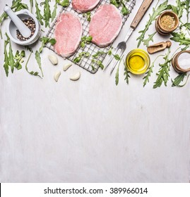Ingredients for cooking pork with herbs and pepper border ,place for text  on wooden rustic background top view