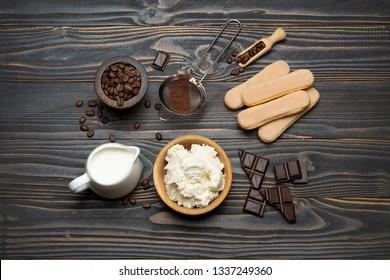 Ingredients for cooking tiramisu - Savoiardi biscuit cookies, mascarpone, cream, sugar, cocoa, coffee and egg