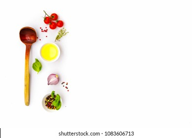 Ingredients for cooking, tomatoes and oil in dish, spices herbs and organic vegetables on a trendy quadruple white plate, healthy food and diet concept, Top view copy space