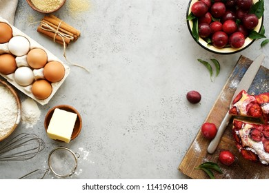 Ingredients and cooking tools for biscuit. Flour, sugar, butter, eggs, cinnamon. Gray food background. Top view