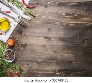 ingredients for cooking vegetarian food, tomatoes, butter, herbs, colorful peppers on wooden rustic background top view border, place for text
