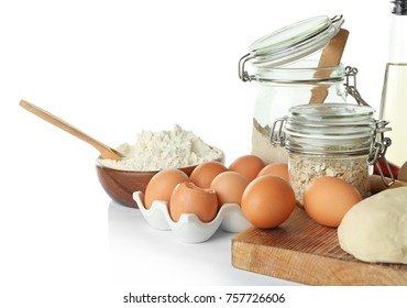 Ingredients for dough and kitchenware on white background