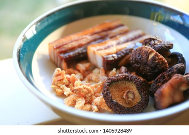 Ingredients as dried shiitake mushroom, dried shrimps and Cantonese dried pork prepared in a bowl