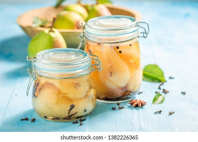 Ingredients for fresh pickled pears on wooden table