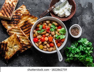 Ingredients for  goats cheese crostini with garlicky beans on a dark background, top view                         - Shutterstock ID 1822862759