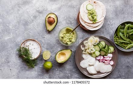 Ingredients guacamole sauce vegetables quinoa taco tortillas