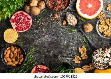 Ingredients of a healthy diet for drawing up a meal plan: wild brown rice, quinoa, spinach, legumes, oranges, grapefruit, almonds, walnuts. Top View