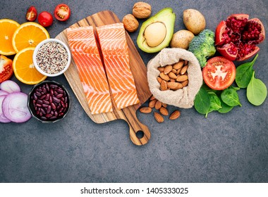 Ingredients for the healthy foods selection  .The concept of healthy food set up on dark concrete background copy space.
