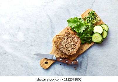Ingredients for healthy home made sandwiches. Rye bread, spinach, young kale, cucumber, radish sprouts. Healthy eating concept. Flatlay