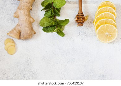 Ingredients for herbal medicine lemon, ginger, mint, honey. Natural products to support the immune system in winter, top view with place for text
