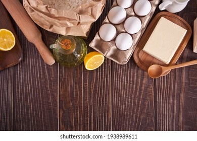 Ingredients for home baking, kitchen utensil on the wooden background. Top view. Copy space.