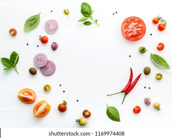 The ingredients for homemade pizza on white wooden background.