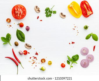 The ingredients for homemade pizza on white wooden background. - Shutterstock ID 1210397221