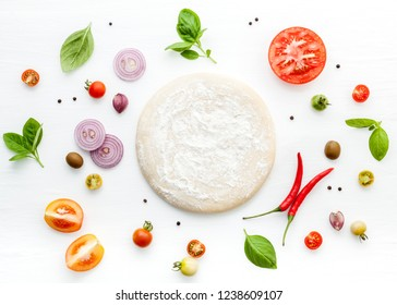 The ingredients for homemade pizza on white wooden background. - Shutterstock ID 1238609107